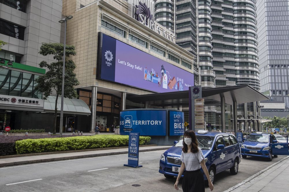 A woman walks past the Suria KLCC shopping mall in Kuala Lumpur October 20, 2020. — Picture by Firdaus Latif