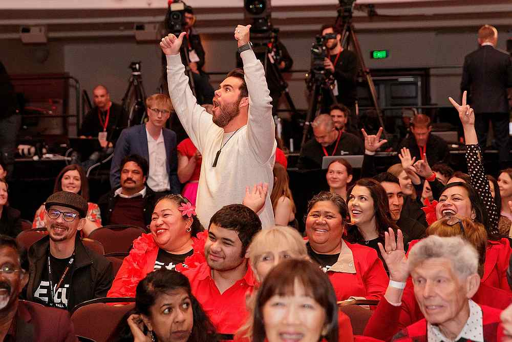 Labour Party supporters cheer as they watch the results come in for the New Zealand general election night event in Auckland, New Zealand, October 17, 2020. — AAP Image via Reuters