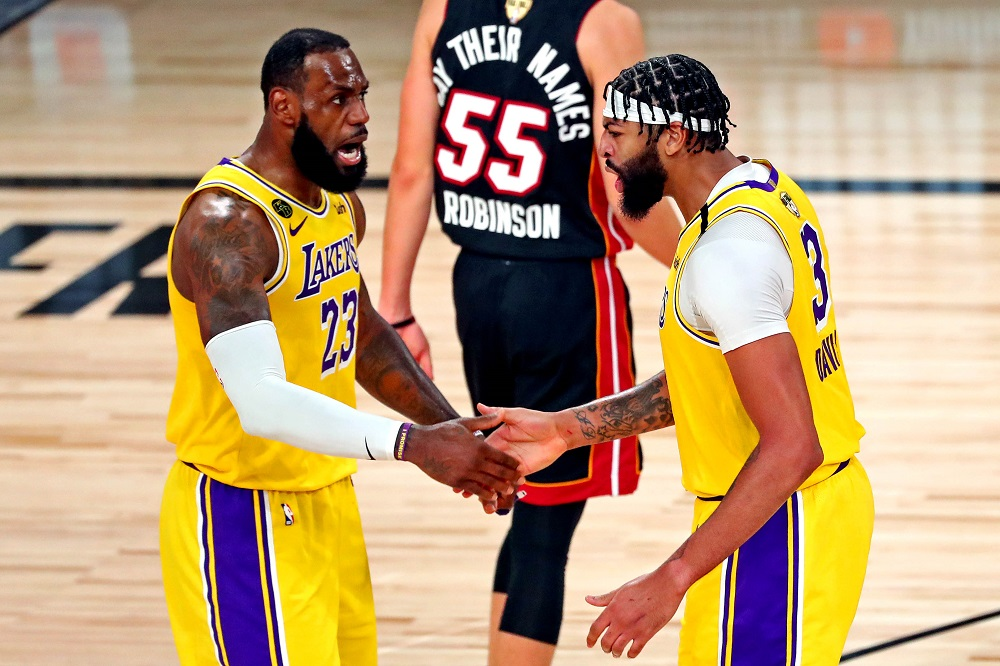 LA Lakers forward Anthony Davis (3) celebrates with forward LeBron James (23) after a play during the third quarter against the Miami Heat in game one of the 2020 NBA Finals at AdventHealth Arena. ― Kim Klement-USA TODAY Sports pic via Reuters