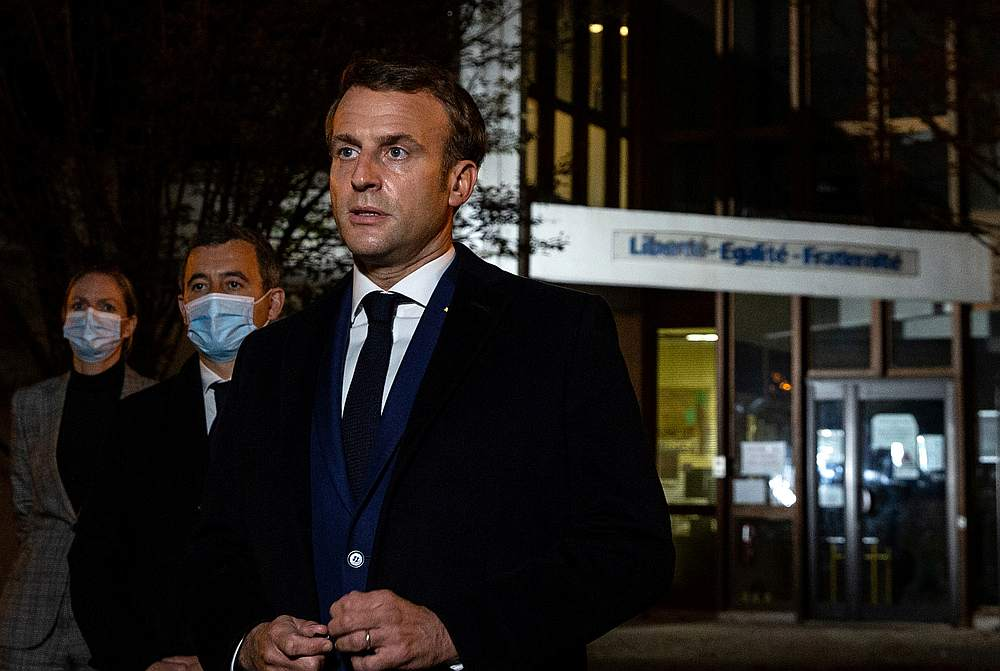 French President Emmanuel Macron, flanked by French Interior Minister Gerald Darmanin, speaks to the press following a stabbing attack in Paris, France October 16, 2020. — Pool pic via Reuters
