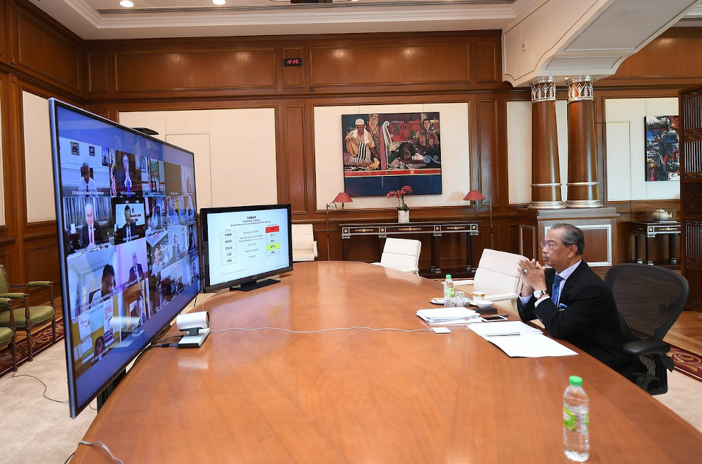 Prime Minister Tan Sri Muhyiddin Yassin chairing the National Security Council special meeting via video teleconferencing on the latest situation of the Covid-19 infections in the country, at his office in Putrajaya October 19, 2020. — Bernama pic