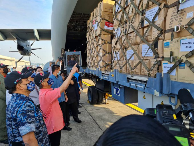 Prime Minister Tan Sri Muhyiddin Yassin inspects the supplies to be sent to Sabah and Sarawak to fight the Covid-19 pandemic. ― Picture via Twitter/bernamadotcom