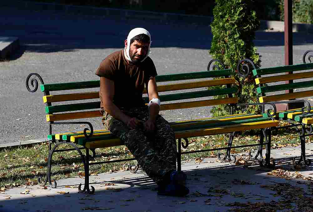 An injured man sits on a bench near a hospital in Stepanakert in the course of a military conflict over the breakaway region of Nagorno-Karabakh, October 17, 2020. — Reuters pic