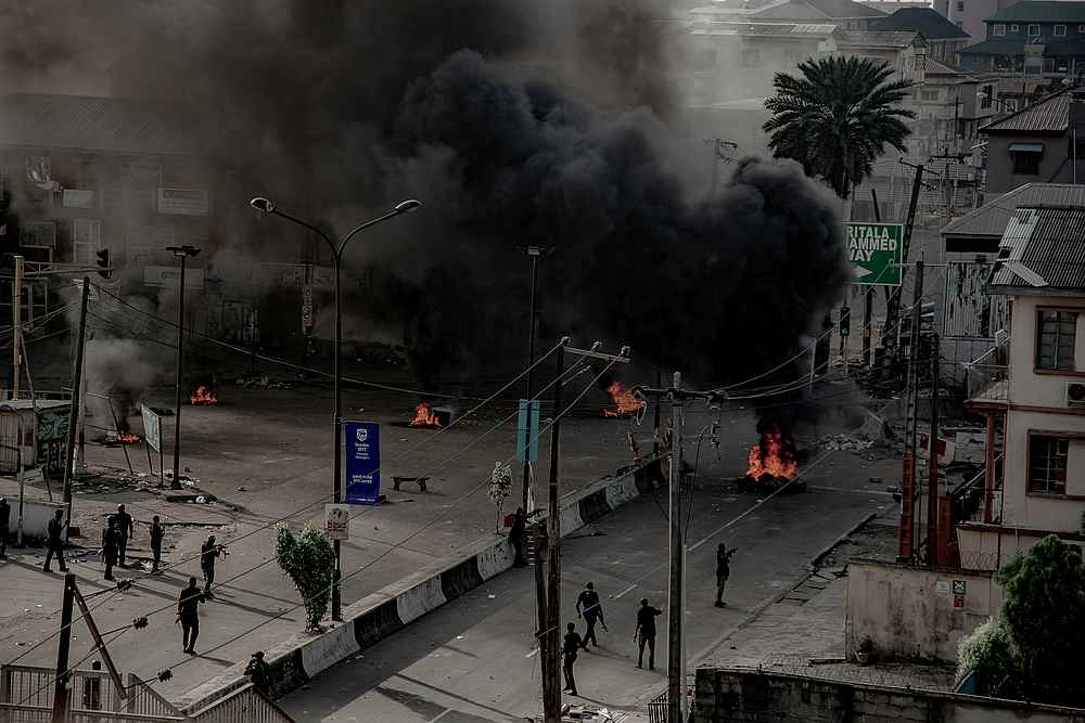 Armed men are seen near burning tires on the street in Lagos, Nigeria October 21, 2020. — UnEarthical/social media image via Reuters
