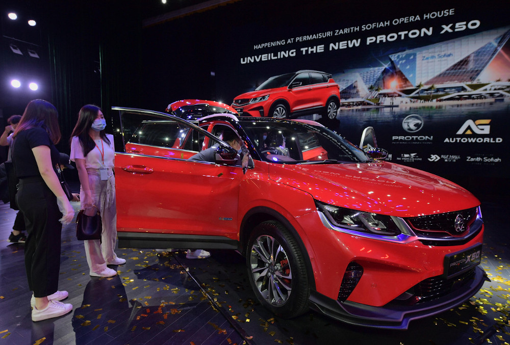 Visitors take a closer look at a Proton X50 at the car's unveiling ceremony at Permaisuri Zarith Sofiah Opera House in Johor Baru, October 27, 2020. — Bernama pic