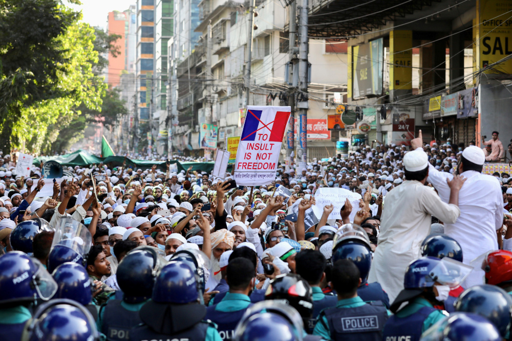 Muslims take part in a protest after Friday prayer, calling for the boycott of French products and denouncing French president Emmanuel Macron for his comments over Prophet Mohammed's caricatures, in Dhaka October 30, 2020. — Reuters pic