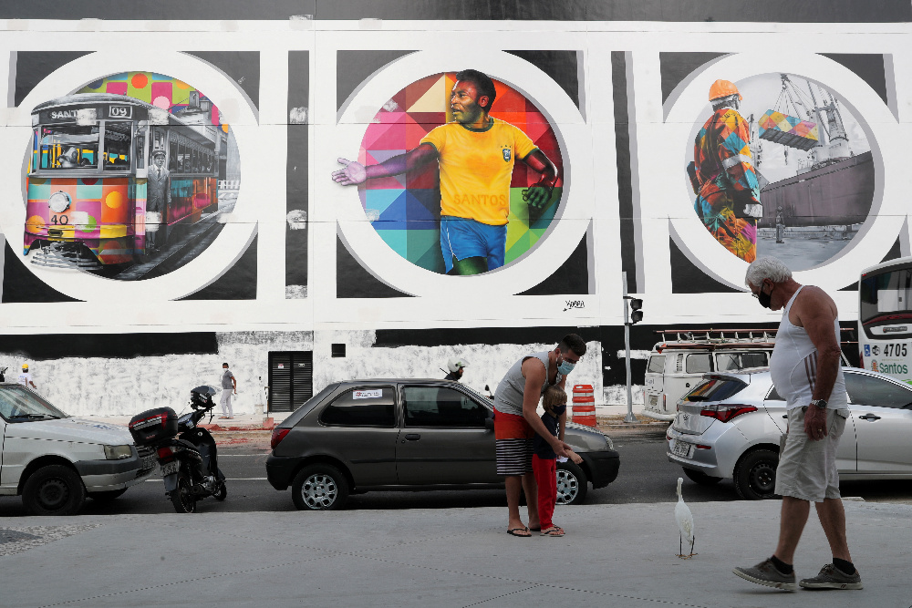 People walk in front of a mural depicting Brazilian football legend Pele in Santos October 20, 2020. Picture taken October 20, 2020. — Reuters pic