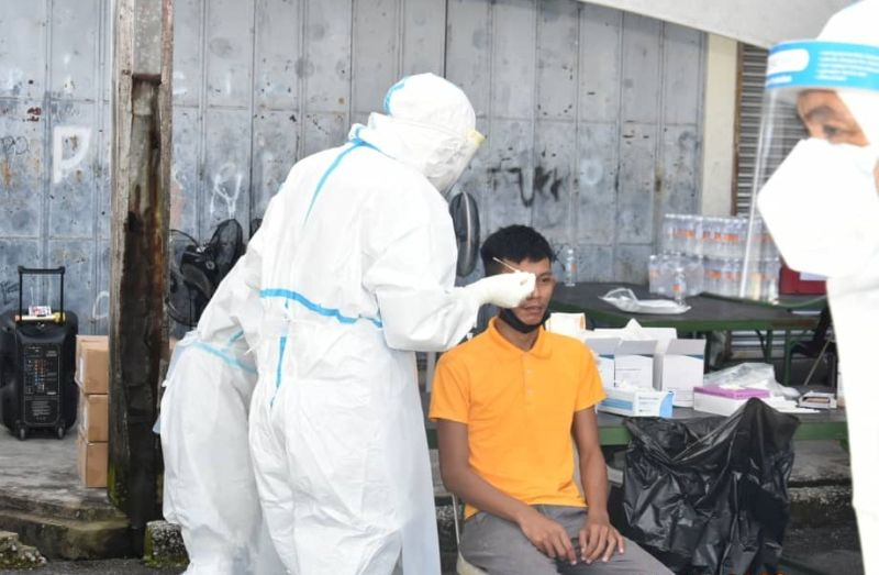 Healthcare staff collect swabs from a villager during the Acting Case Detection operation at Kampung Haji Baki outside Kuching City October 25, 2020. — Picture courtesy of Deputy Chief Minister's Office