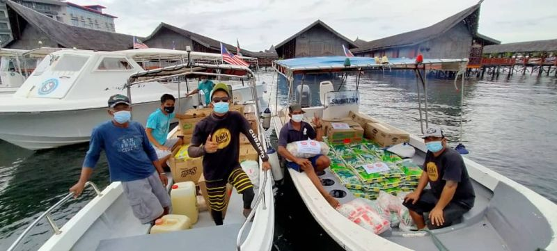 Semporna Heroes, a coalition of some 20 NGOs, have been sending rescue food packs and milk to local Bajau Laut communities who live on floating communities out at sea.— Picture courtesy of Semporna Heroes