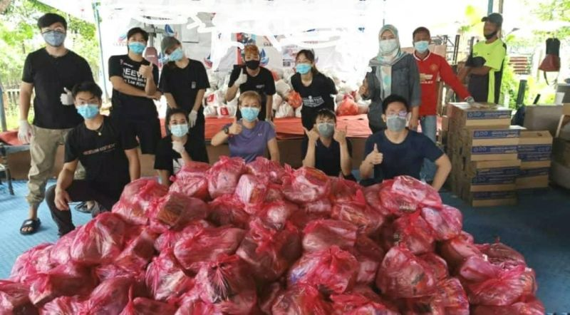Members of Sabah Next Generation came together to pool resources and raise funds for food supplies to help the needy in and around Tanjung Aru. — Picture courtesy of Semporna Heroes