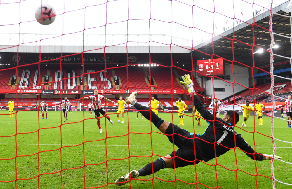 Sheffield United's Billy Sharp scores their first goal from the penalty spot in a match against Fulham at Bramall Lane, Sheffield, October 18, 2020. — Reuters pic