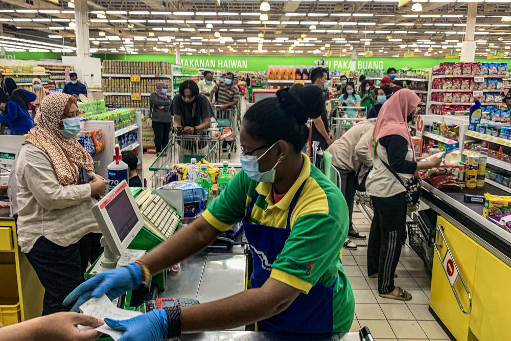 Members of the public shop for groceries at the Giant supermarket in Batu Caves ahead of the conditional movement control order on October 13, 2020. — Picture by Hari Anggara