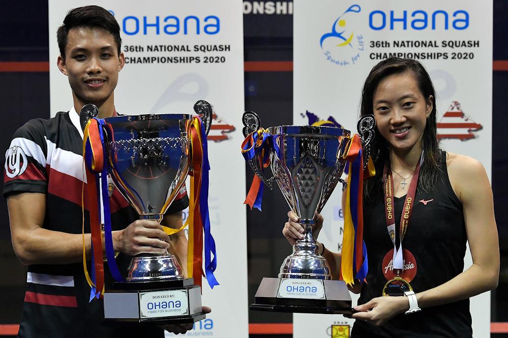 """袁艾文(左)和""""壁球甜心""""刘薇雯(右)成功卫冕全国壁球赛男女单冠军,称王封后。-马新社-"""