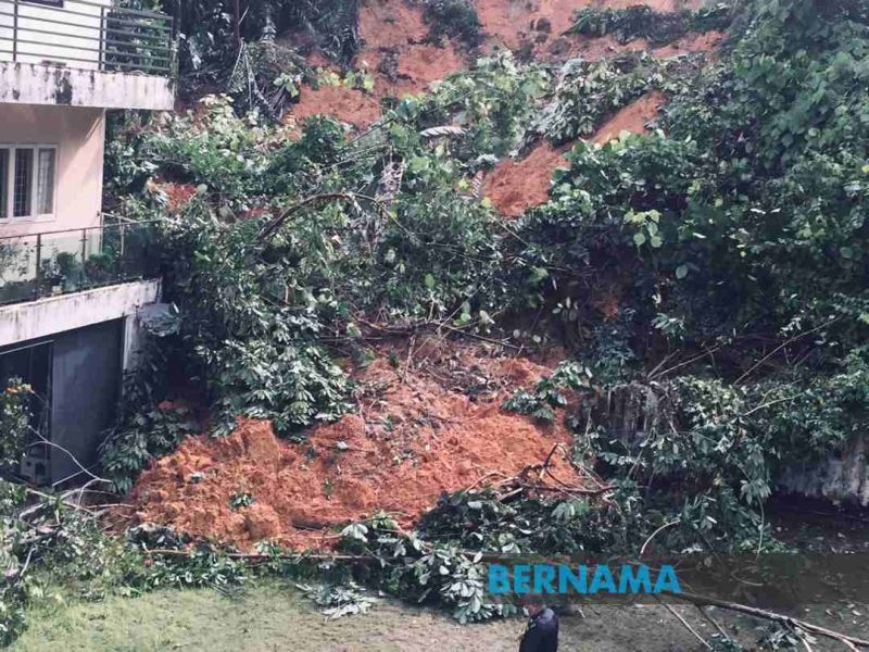 Fire and Rescue personnel noticed soil erosion at the embankment, affecting six apartment units on the lower ground. — Picture via Twitter