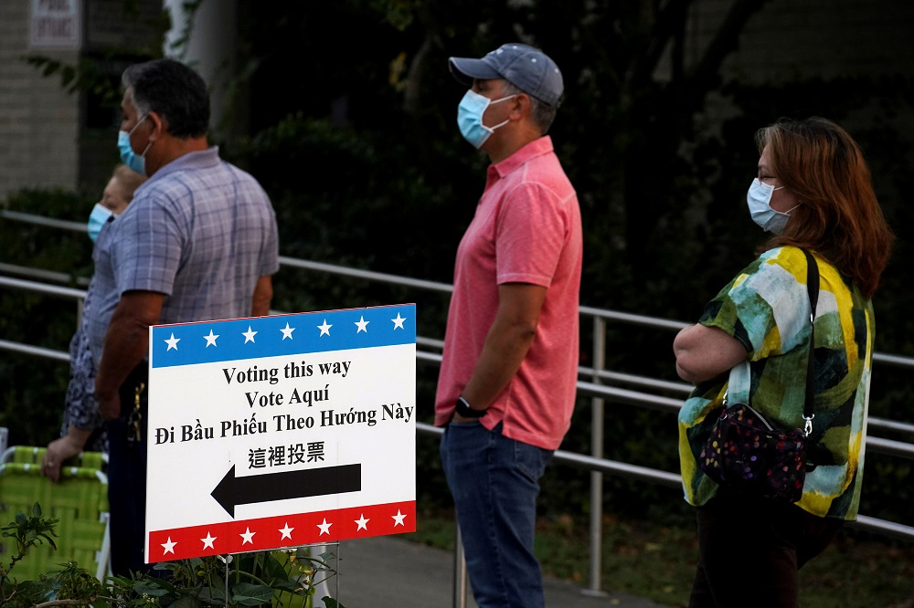 People wait in line to cast their ballots for the upcoming presidential election as early voting begins in Houston, Texas October 13, 2020. ― Reuters pic