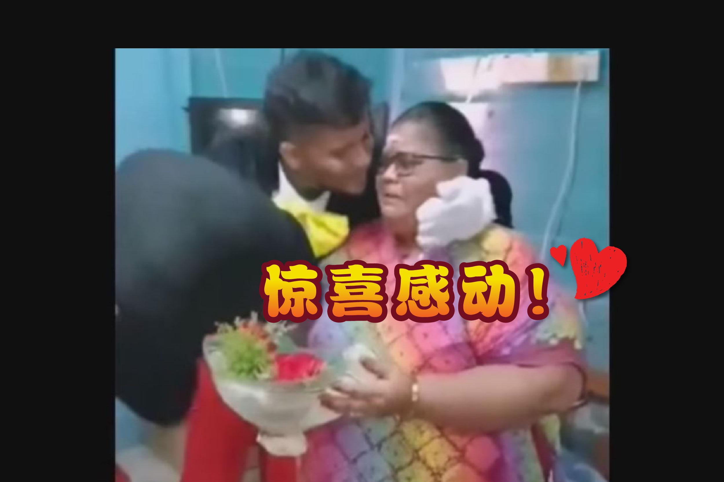 当穿着米奇装的塔纳巴兰看到母亲落泪时,忍不住拆下头套拥抱母亲并献吻。-视频截屏/j精彩大马制图-