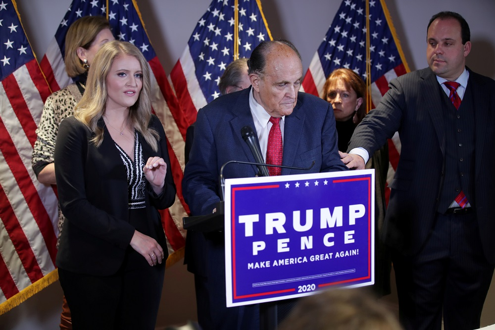 Trump Campaign Senior Legal Advisor Jenna Ellis speaks as Trump campaign advisor Boris Epshteyn reaches out to former New York City Mayor Rudy Giuliani personal attorney to US President Donald Trump during a news conference in Washingt