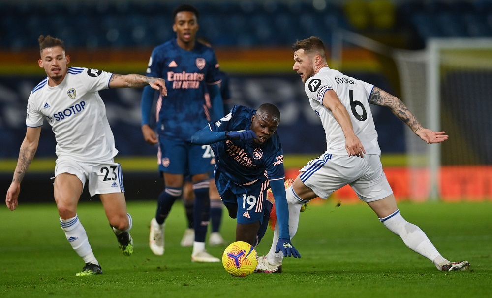 Arsenal's Nicolas Pepe in action with Leeds United's Kalvin Phillips and Liam Cooper during the match at Elland Road in Leeds November 22, 2020. — Pool pic via Reuters