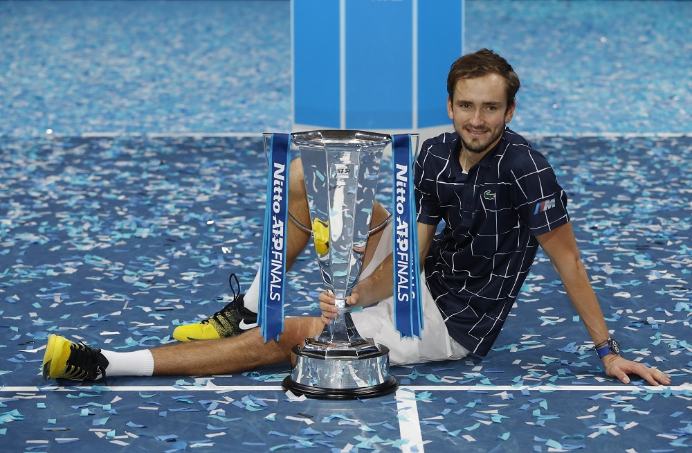 Russia's Daniil Medvedev celebrates with the trophy after winning the final match against Austria's Dominic Thiem at the O2 stadium in London November 22, 2020. — Action Images via Reuters