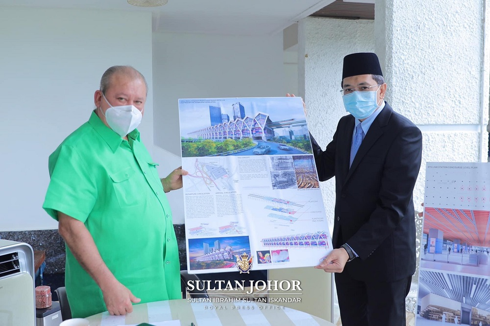 Sultan Ibrahim Sultan Iskandar (left) holding up images for the Johor Baru-Singapore Rapid Transit System project after being briefed on the project that is set to be virtually launched on November 22, in conjunction with his birthday. — Picture via Facebook/Sultan Ibrahim Sultan Iskandar