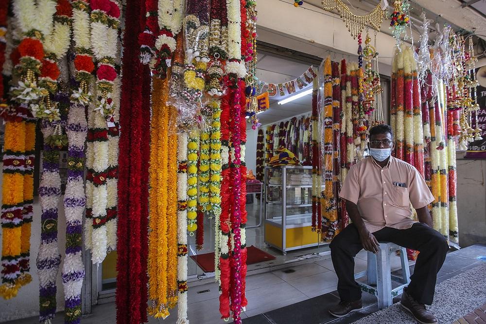 Vijayan Somasundram waits for customers outside his shop in Brickfields ahead of the Deepavali celebrations in Kuala Lumpur November 12, 2020.