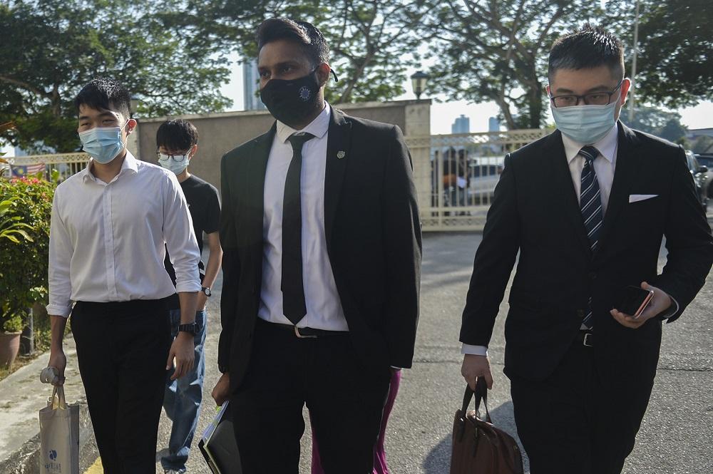 University of Malaya Association of New Youth (Umany) ex-president Wong Yan Ke (left) and his lawyers arrive at the Petaling Jaya magistrate court November 13, 2020.