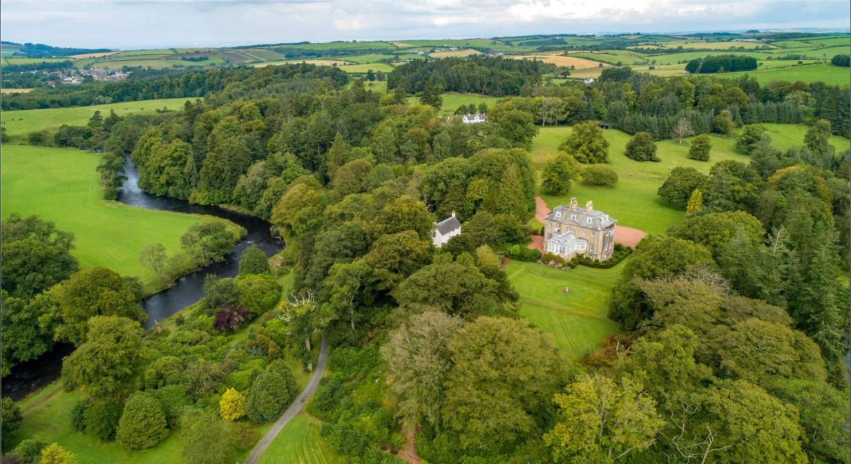 An aerial view of Skeldon House, located on the 18th-century Ayrshire estate in Scotland. — Screen capture via Savills.com