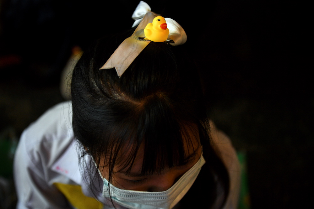 A small rubber duck is attached to the head of a pro-democracy protester demanding the resignation of Thailand's Prime Minister Prayut Chan-o-cha and reforms on the monarchy during a rally in Bangkok, Thailand November 21, 2020. — Reuters pic