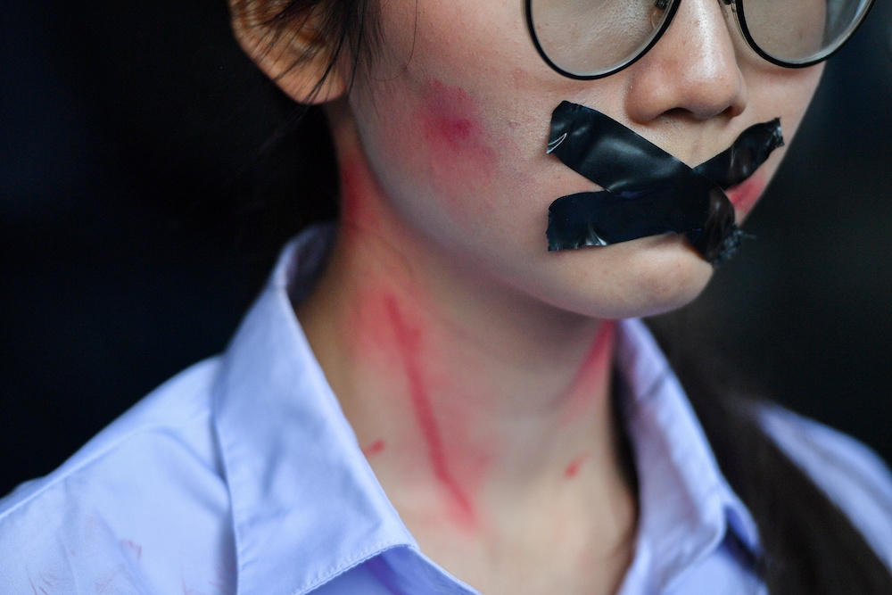 A student has her mouth covered with tape as pro-democracy protesters gather during a rally in Bangkok, Thailand November 21, 2020. — Reuters pic