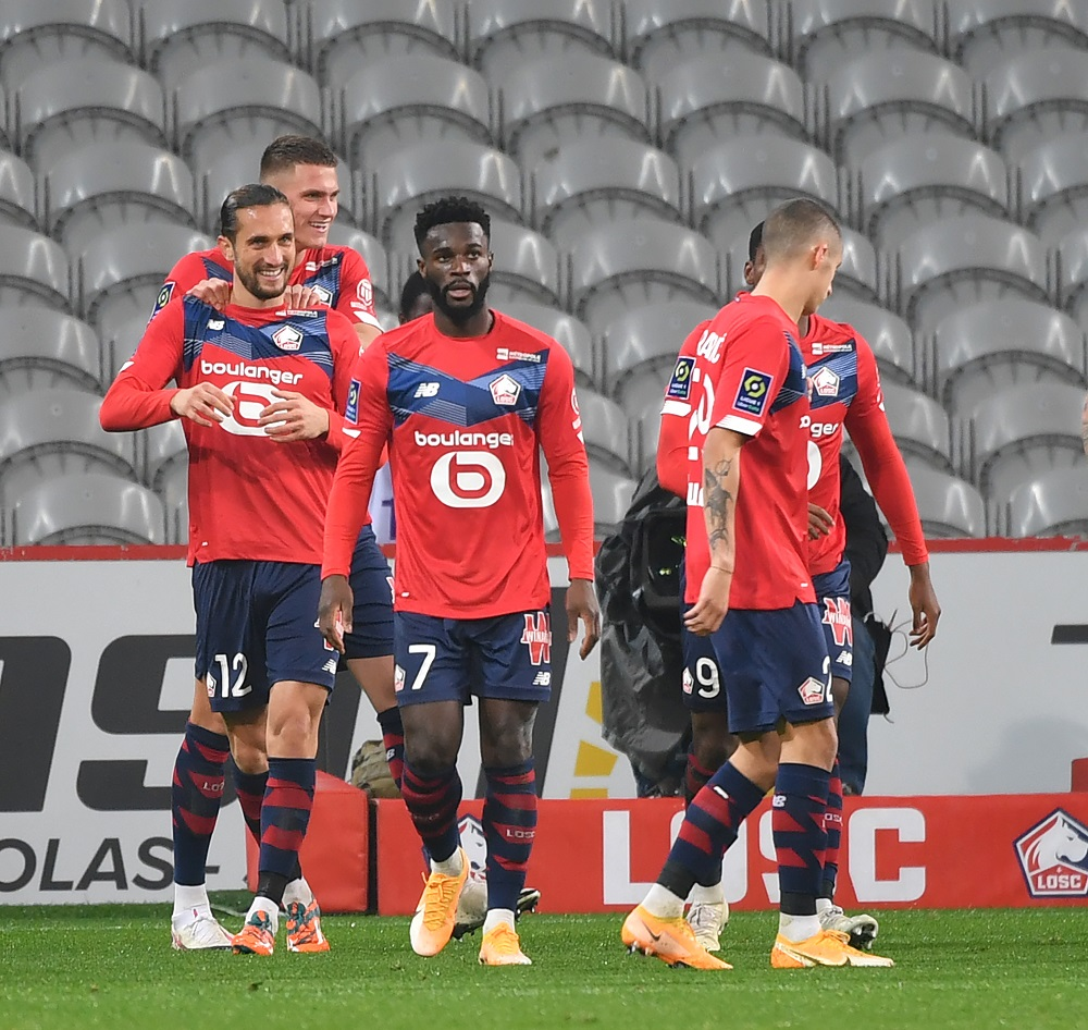 Lille's midfielder Yusuf Yazici (left) celebrates a goal with his teammates during the French L1 football match between Lille OSC and FC Lorient at the Pierre-Mauroy stadium in Villeneuve-d'Ascq, northern France November 22, 2020. — AFP pic