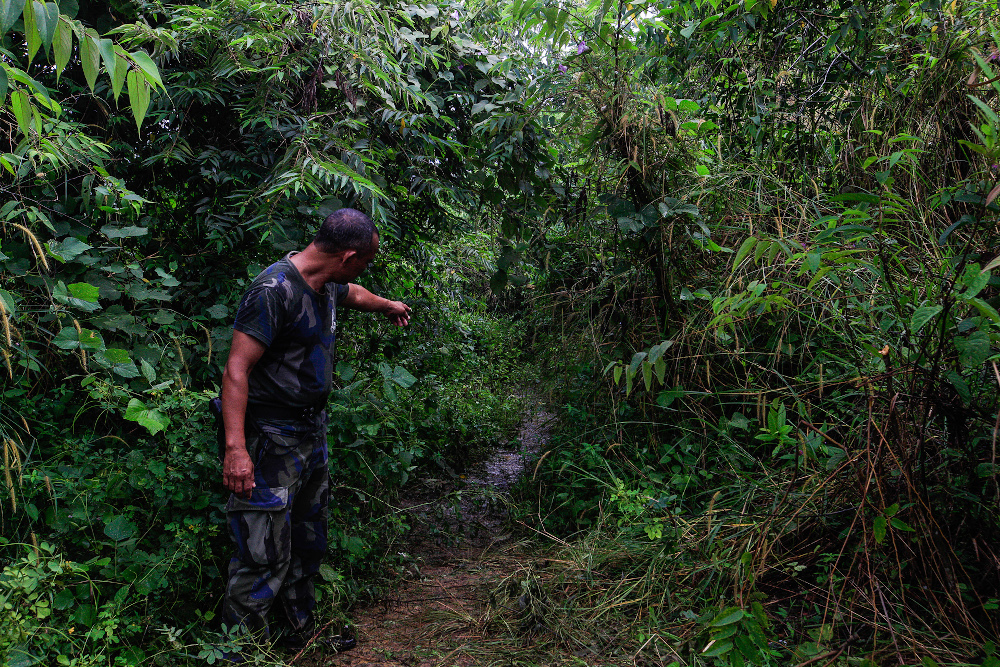 File photo of Judin Alwie, 43, one of the PGA personnel under the 3rd Battallion showing the place where the late Baharuddin Ramli`s body was found after the shootout here in Padang Besar November 24, 2020. — Picture by Sayuti Zainudin