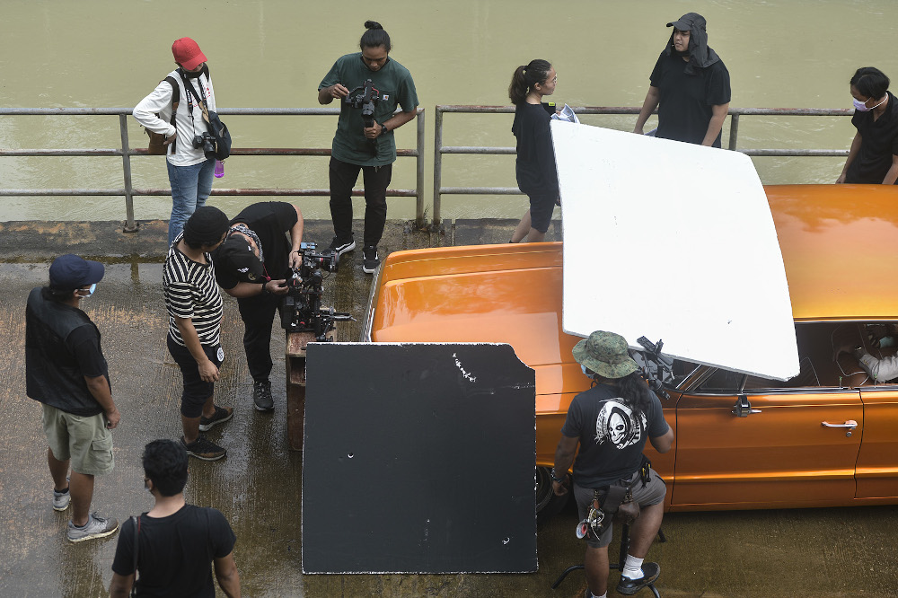 A film production crew shooting on set during the conditional movement control order (CMCO) in Shah Alam November 28, 2020. — Picture by Miera Zulyana