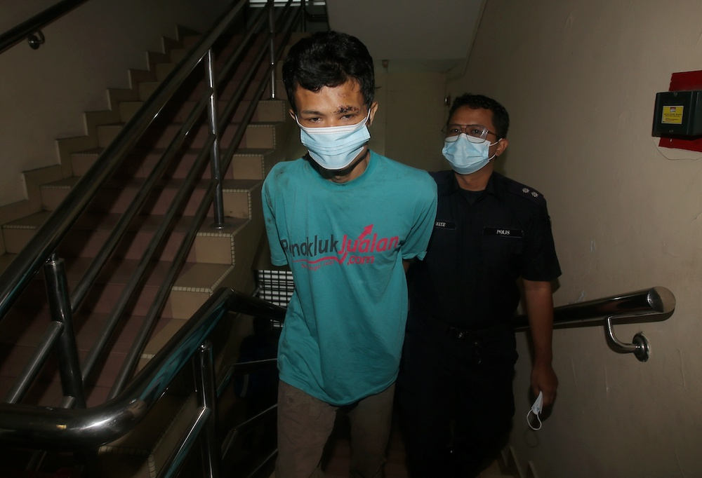 Nor Azman Mat Salleh, 35, claimed trial at the Magistrate's Court in Ipoh for ramming his motorcycle into a traffic police officer who was on duty at a roadblock. — Picture by Farhan Najib