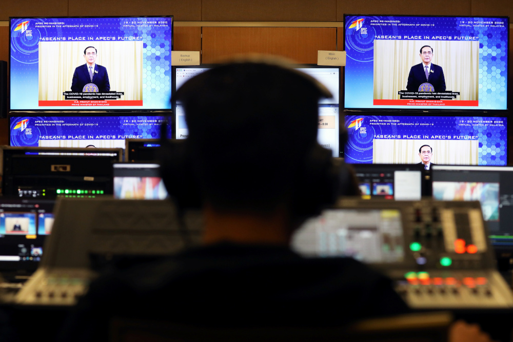 Screens show Thailand's Prime Minister Prayuth Chan-ocha speaking during the virtual Apec CEO Dialogues 2020, at its command centre in Kuala Lumpur, November 19, 2020. — Reuters pic