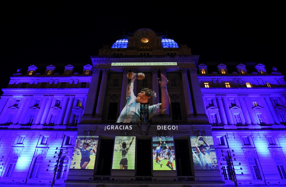 Photographs of late football legend Diego Maradona are projected on the Kirchner Cultural Centre, in Buenos Aires November 25, 2020. ― Reuters pic