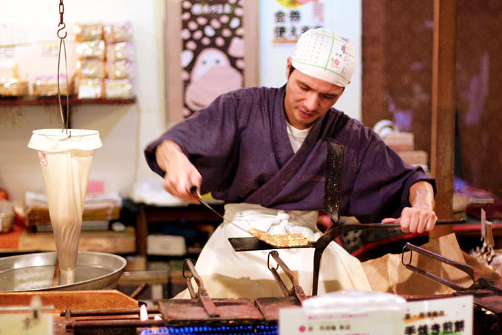 Japanese street vendors busy grilling, roasting and baking autumnal treats