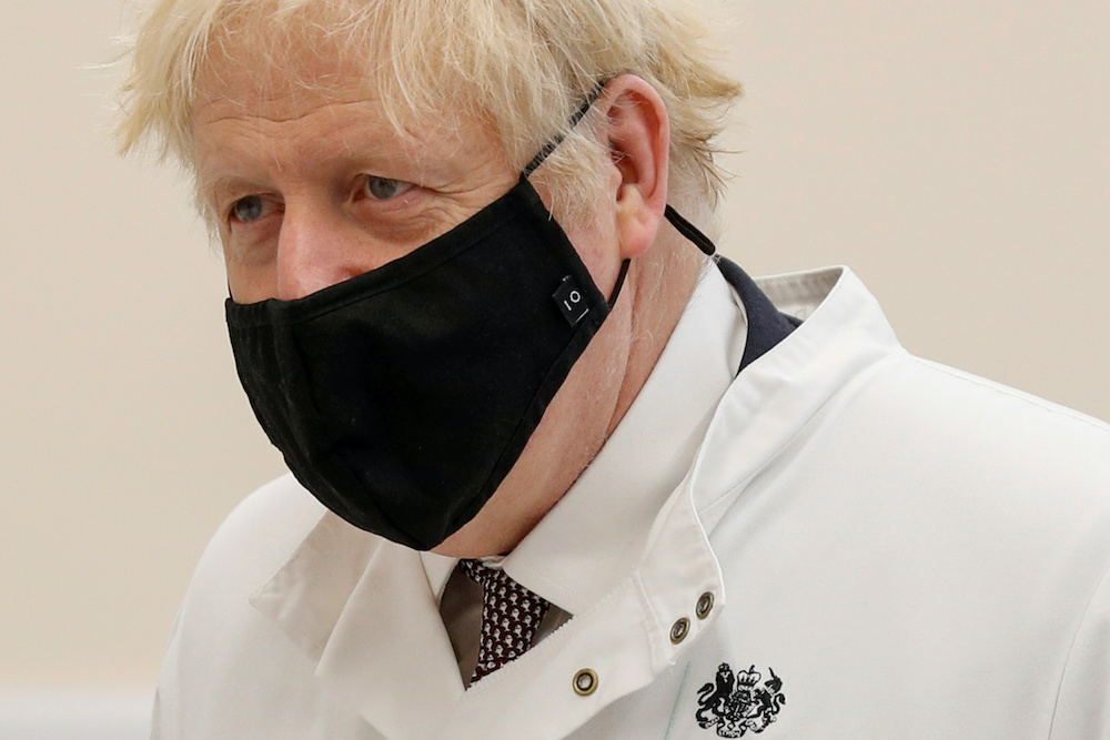 Britain's Prime Minister Boris Johnson wears a face mask as he visits the Public Health England site at the Porton Down science park, near Salisbury, Britain November 27, 2020. — Reuters pic