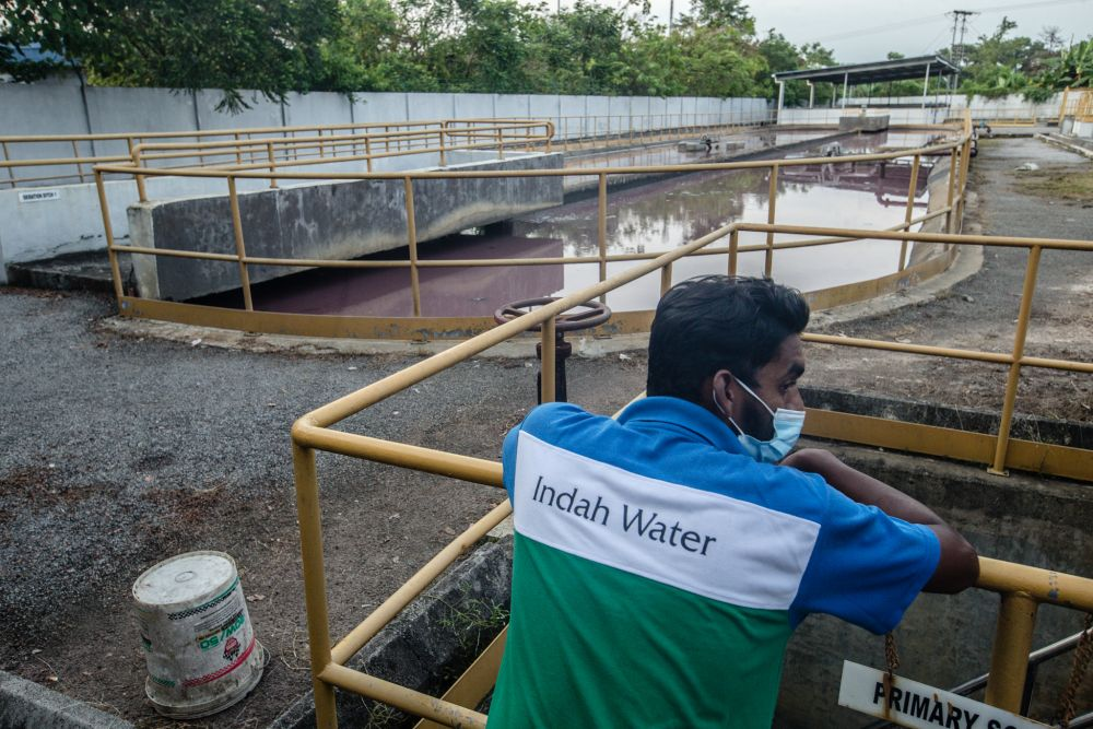 A worker looks on at an Indah Water treatment plant in Rawang November 10, 2020. — Picture by Firdaus Latif