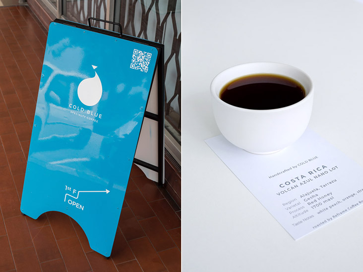 The striking aquamarine sign that leads you to Cold Blue Coffee Specialty Coffee where handcrafted filter coffee awaits