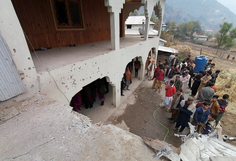 Locals gather near a house, which was damaged, according to them, by cross-border shelling, in Neelum Valley, in Pakistan-administrated Kashmir, November 13, 2020. — Reuters pic