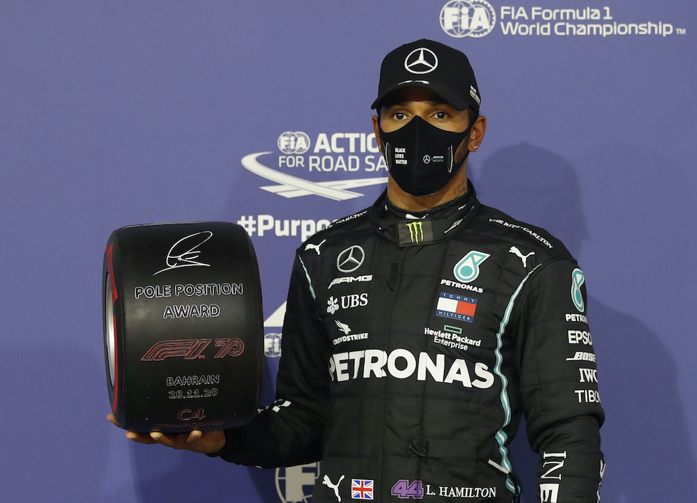 Mercedes' Lewis Hamilton celebrates with an award after qualifying in pole position at the Bahrain International Circuit in Sakhir, Bahrain, November 28, 2020. — Reuters pic