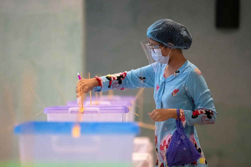 A woman wearing a protective face masks casts her ballot for the general election at a polling station in Yangon in this file picture taken on November 8, 2020. — Reuters pic