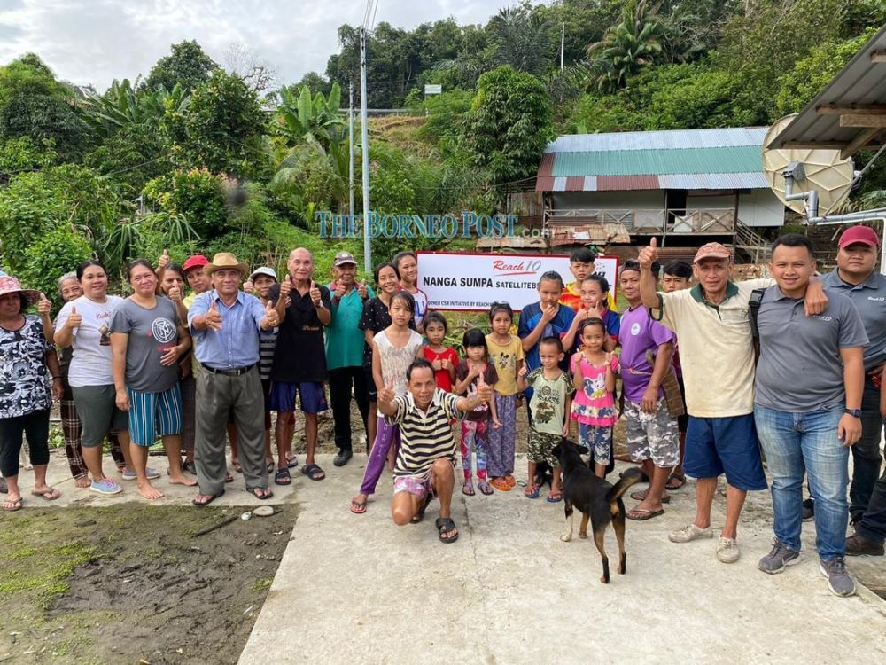 The Nanga Sumpa community poses for a photo after successfully receiving internet connectivity. — Picture via Borneo Post