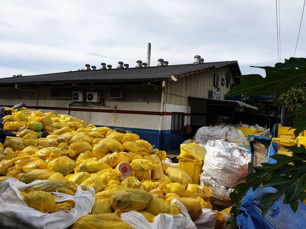 Piled up medical waste outside the Sedafiat waste management firm's compound in Lok Kawi, Sabah has created concern among members of the public
