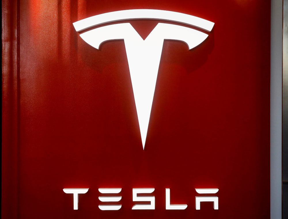 The Tesla logo is seen at the entrance to Tesla Motors' showroom in Manhattan's Meatpacking District in New York City, US, December 14, 2017. — Reuters pic