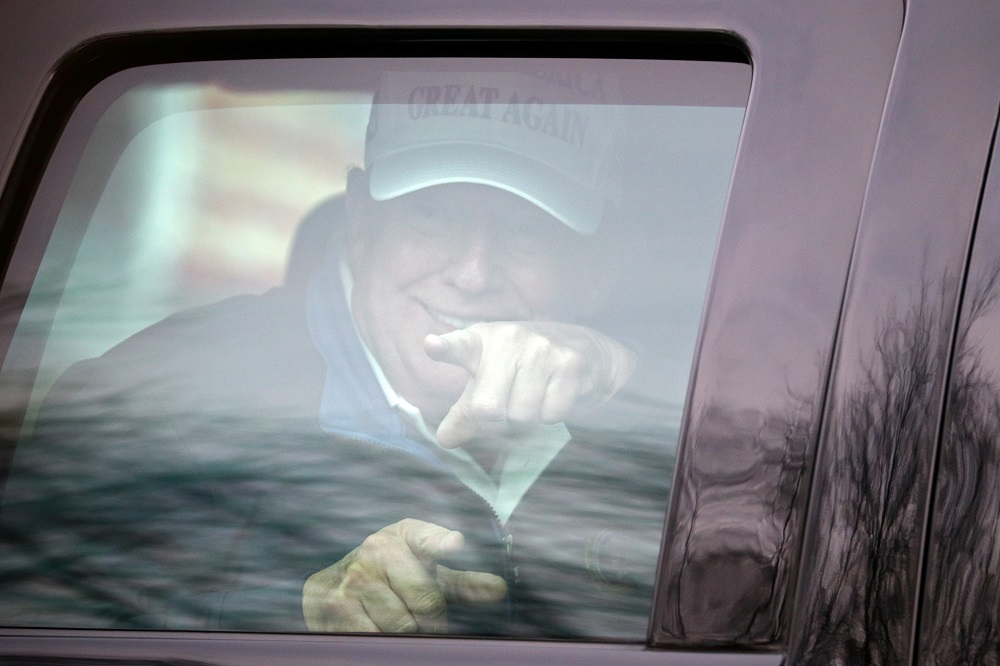 US President Donald Trump gestures as his motorcade leaves the Trump National Golf Club in Sterling, Virginia November 22, 2020. ― Reuters pic