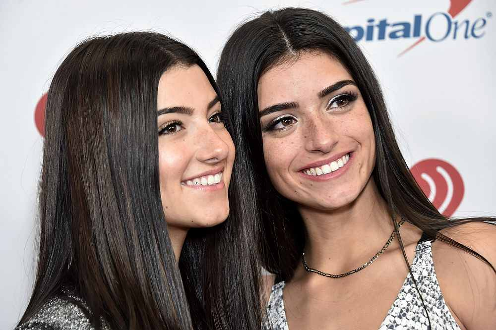 Charli D'Amelio (left) has helped her sister Dixie (right) reach over 93 million views on YouTube with her video 'Be Happy.' — AFP pic