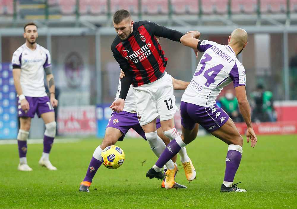 AC Milan's Ante Rebic (centre) in action with Fiorentina's Sofyan Amrabat in the Serie A match at San Siro, Milan, Italy November 29, 2020. — Reuters pic