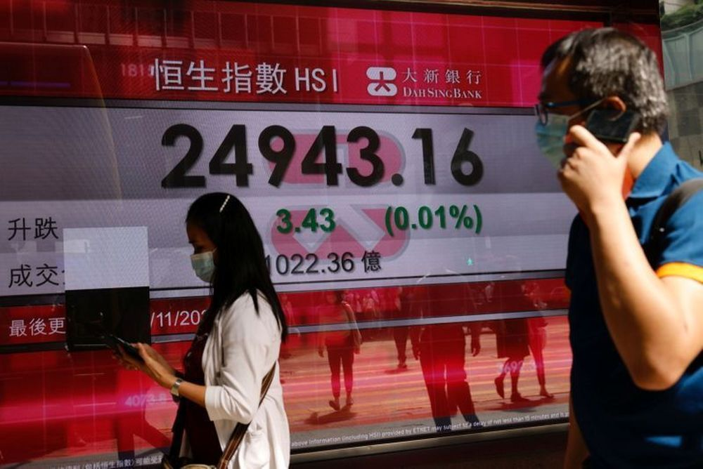 Asian shares fell slightly today, pulling back from a record high hit earlier this week. — Reuters pic