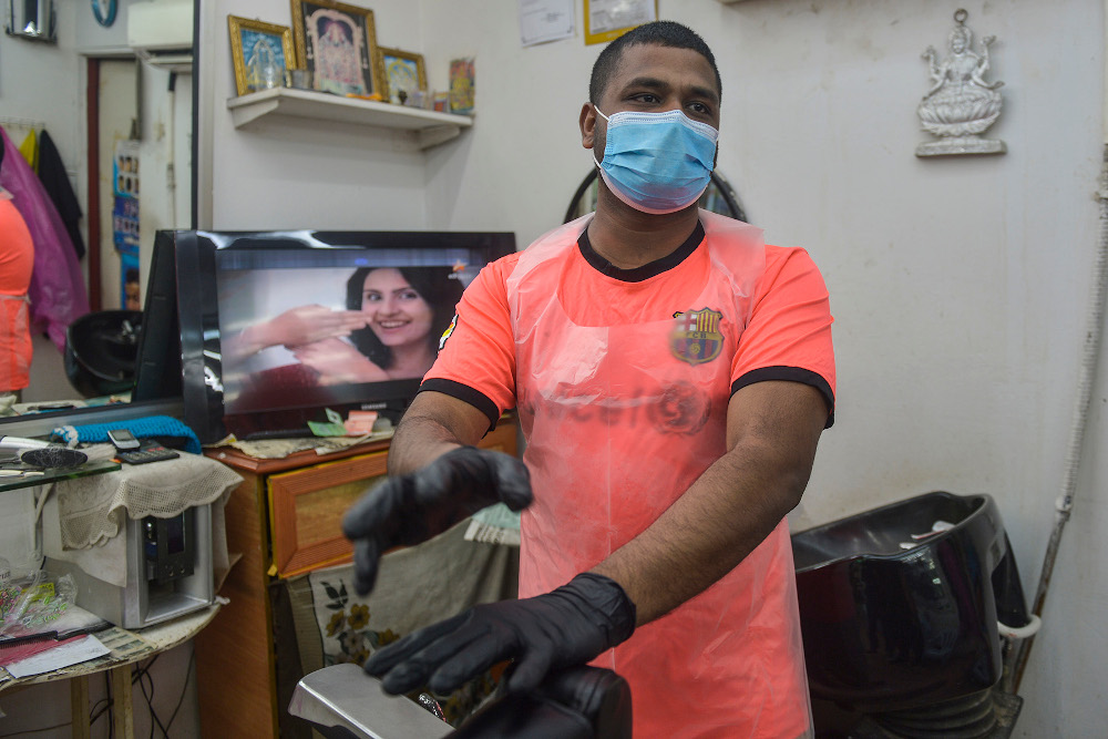 Barbers and hairdressing salons have been hurt hard by the pandemic. — Picture by Miera Zulyana